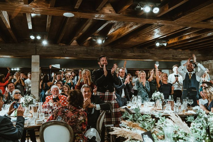 Guests enjoy winter wedding with cosy stying and foliage table decor
