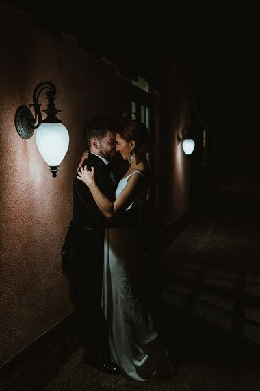 Bride and groom embrace at winter wedding