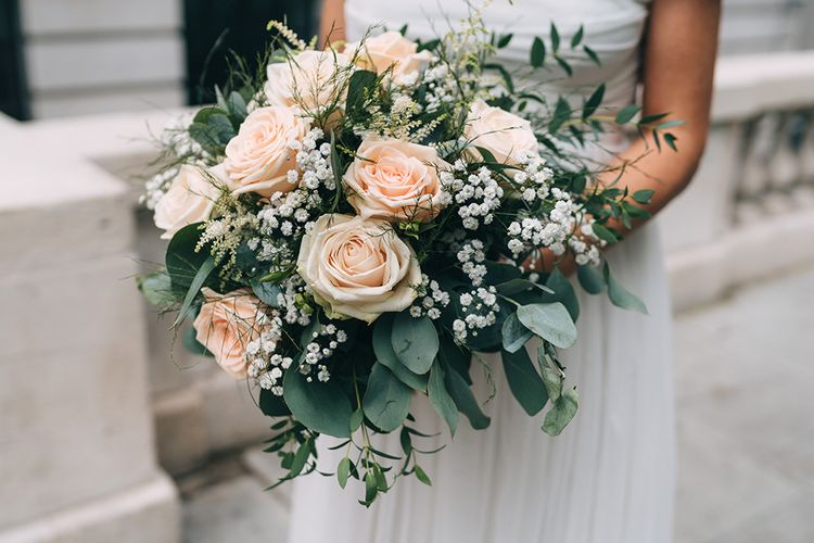 Classic bridal bouquet with pink roses, eucalyptus and gypsophila
