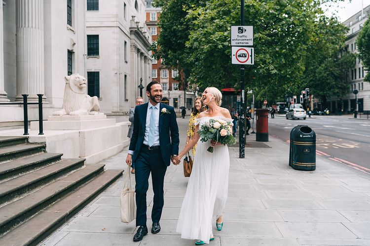 Bride and groom entering the wedding ceremony at Old Mar