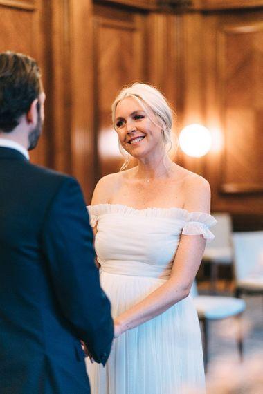 Bride in off the shoulder tulle wedding dress