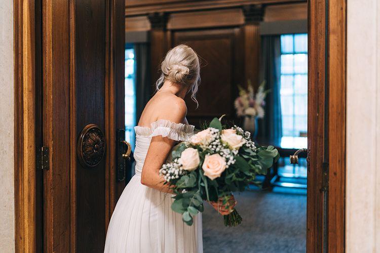 Bride with messy bun, bridal updo