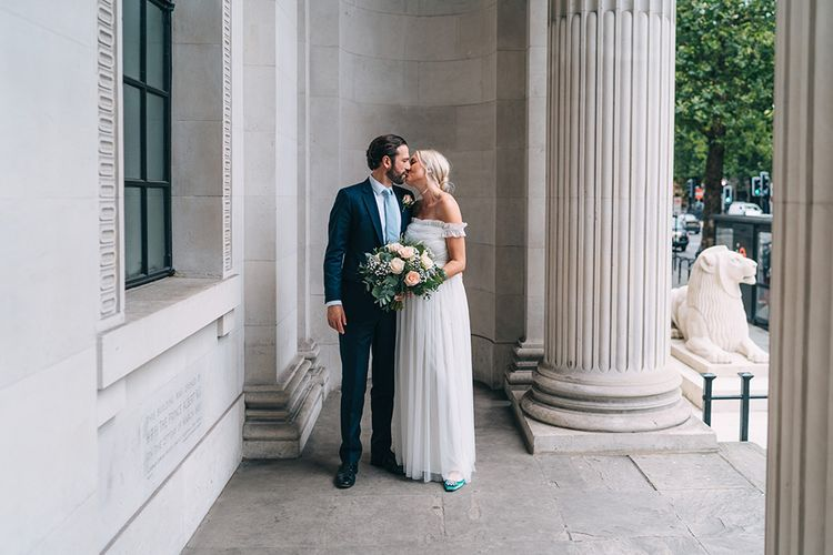 Bride and groom portrait outside Old Marylebone Town Hall by Miss Gen