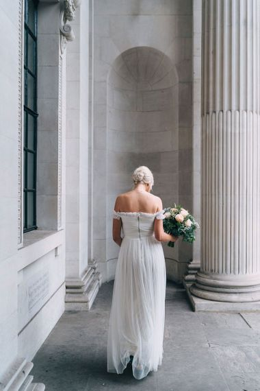 Bride in tulle off the shoulder wedding dress from the high street