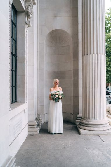 Bride in tulle maternity wedding dress from the high street
