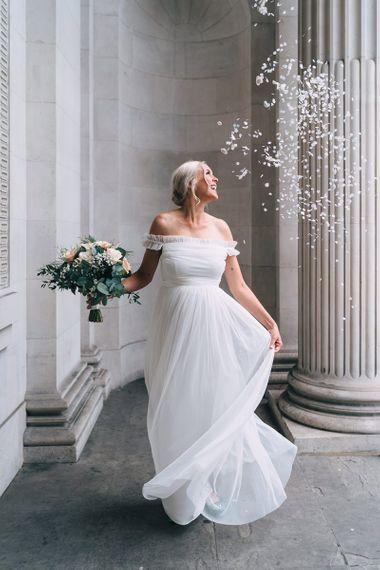 Beautiful pregnant bride in maternity wedding dress