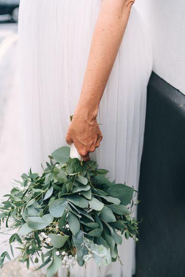 Hand tied wedding bouquet with eucalyptus