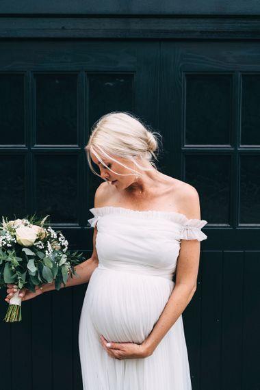 Pregnant bride in off the shoulder maternity wedding dress