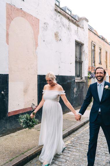 Bride and groom portrait walking through London streets