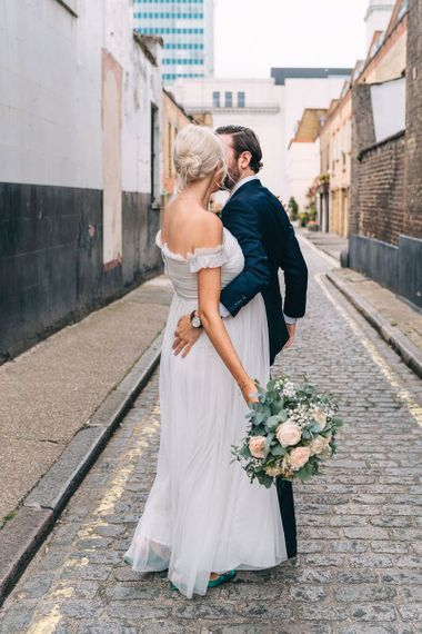 Bride and groom dancing in the streets in London