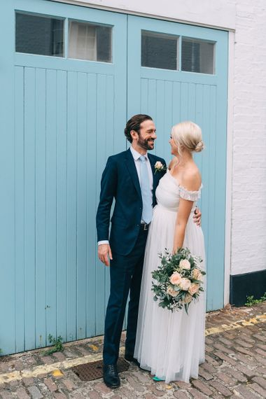 Post COVID intimate London wedding with bride in maternity wedding dress