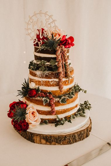 Semi Naked Wedding Cake With Fresh Flowers // Glamorous Iscoyd Park Wedding With Burgundy, Navy And Ivory Colour Scheme With Artistic And Alternative Images From Carla Blain Photography
