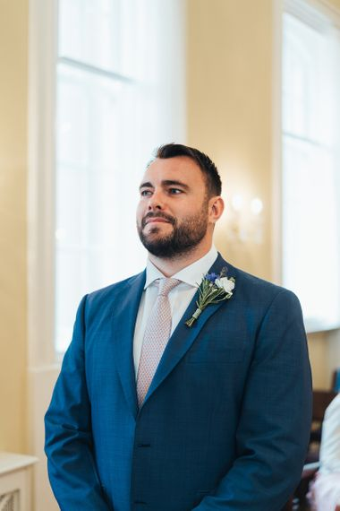 Groom Waiting For Bride During Ceremony At Town Hall