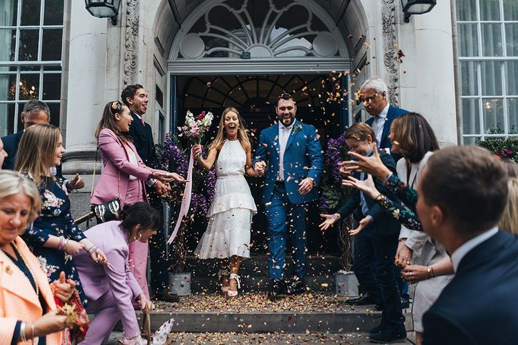 Bride and Groom Confetti Exit on Chelsea Town Hall Steps