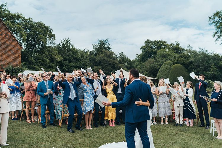 Wedding Guests Cheering at the Outdoor Wedding Ceremony