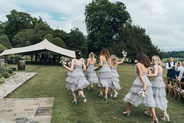 Bridesmaids in Embroidered Tulle Needle and Thread Dresses Walking Toward the Stretch Tent Marquee Reception