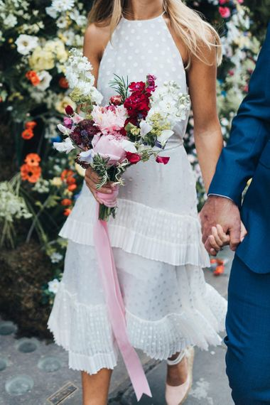 Wedding Dress Details with Pink Flowers