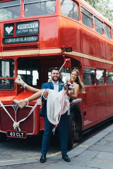 Groom Picks Up Bride