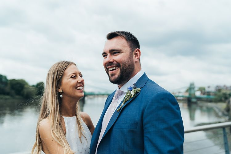 Bride and Groom Portrait In Front Of River