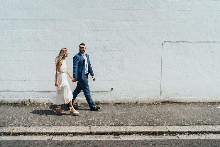 Bride and Groom Walking Down The Street