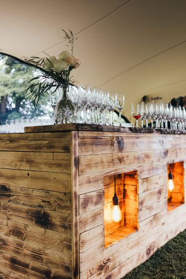 Wooden Bar with Edison Bulb Lights by Miss Gen