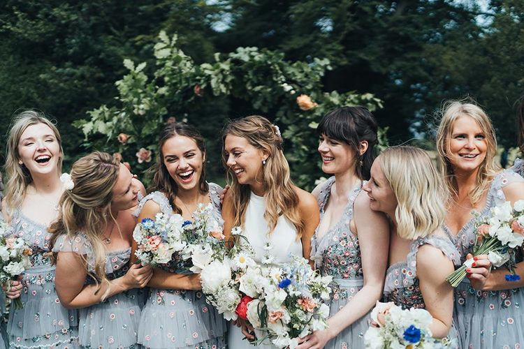Bridal Party Portrait Bride in Made With Love Wedding Dress Laughing with Her Bridesmaids in Needle and Thread Dresses