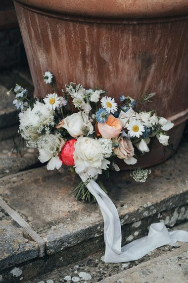 Delicate Wedding Bouquet with Peonies and Wildflowers Tied with Ribbon