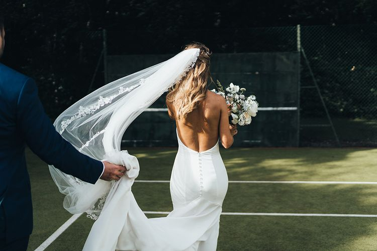 Bride in Backless Made With Love Wedding Dress with Button Detail