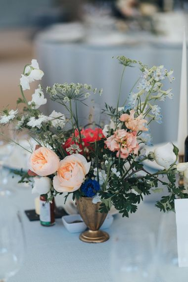 Bright Wedding Flowers in Gold Vessel as Table Centrepiece