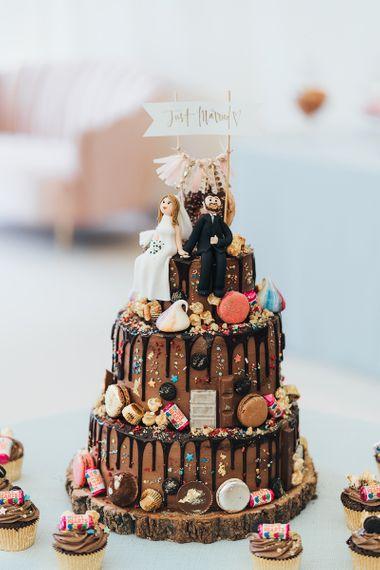 Chocolate Drip Wedding Cake Decorated with Macaroons