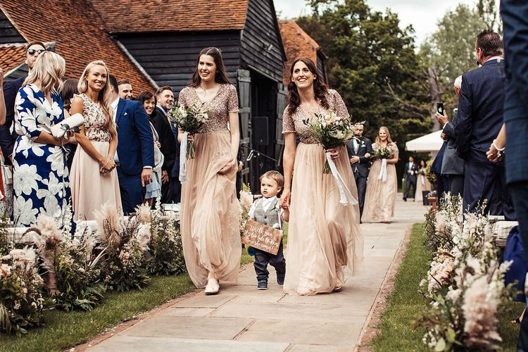 Bridesmaids In Pink Dresses Walk Down The Aisle