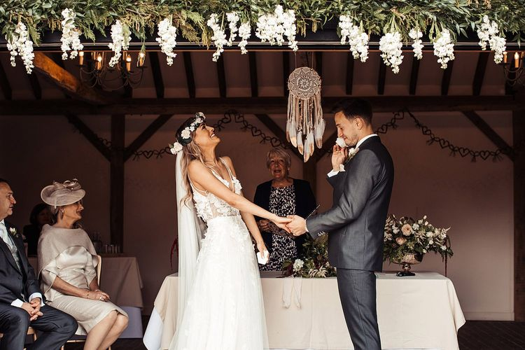 Bride Wears Flower Crown As Couple  Exchange Vows