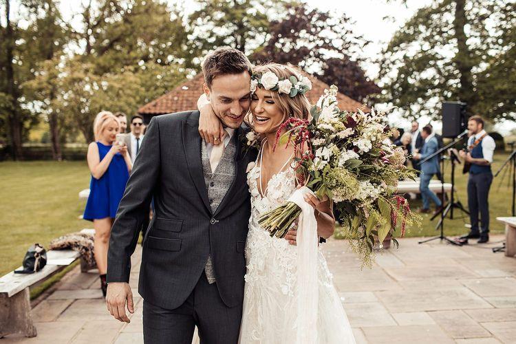 Bride Holds Wedding Bouquet Wearing Flower Crown