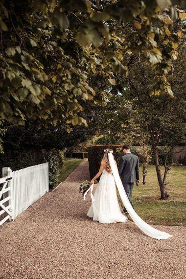 Bride and Groom Walk Through Blake Hall Venue Grounds