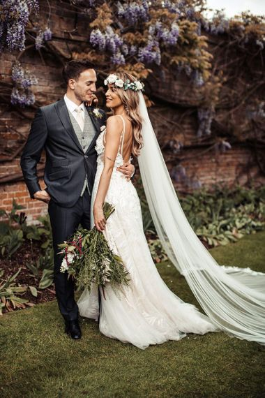 Beautiful Bride and Groom With Bouquet and Flower Crown