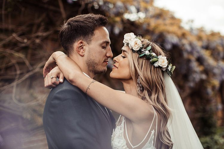 Bride and Groom Embrace During Barn Wedding