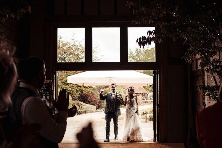 Bride and Groom Make Entrance to Barn Wedding Reception