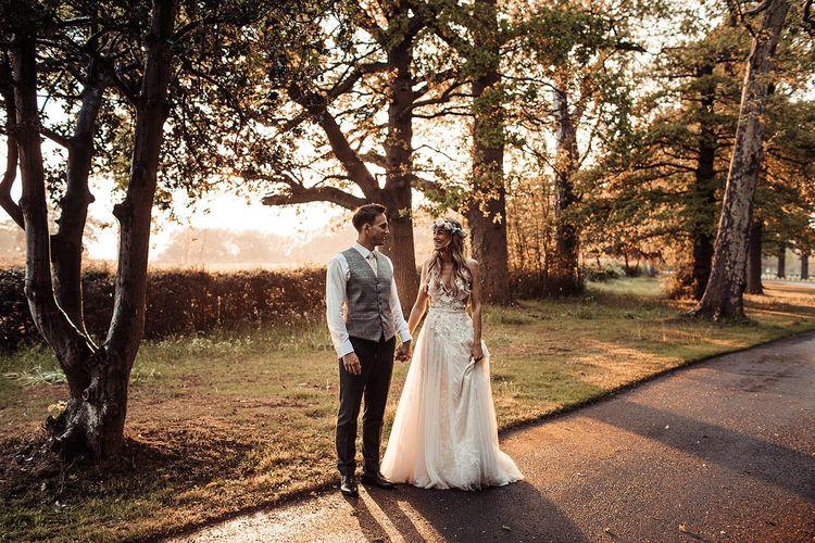 Bride and Groom Walk Through Essex Wedding Venue Grounds