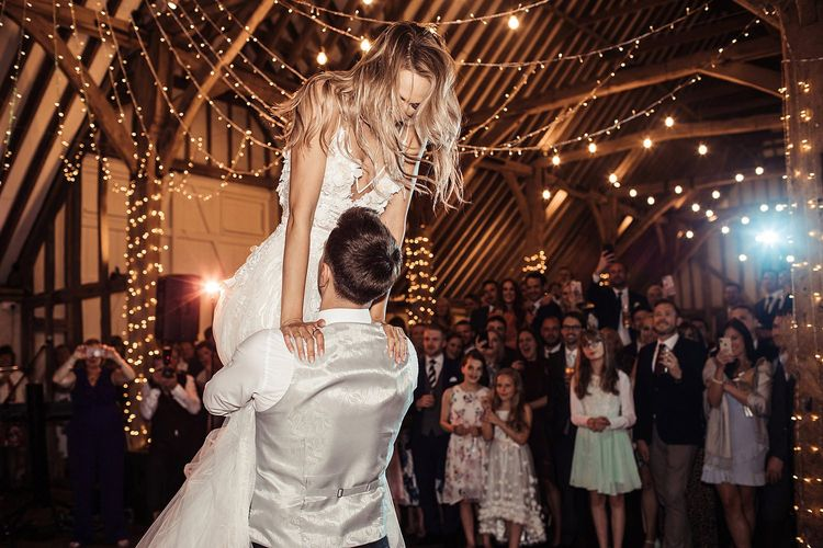 Bride and Groom First Dance In Barn Wedding with Fairy Lights