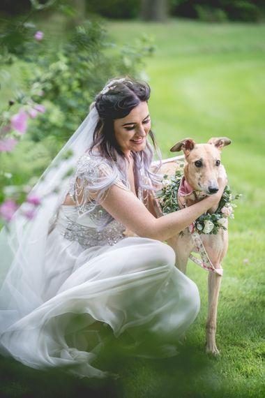 Bride with pet dog at wedding venue