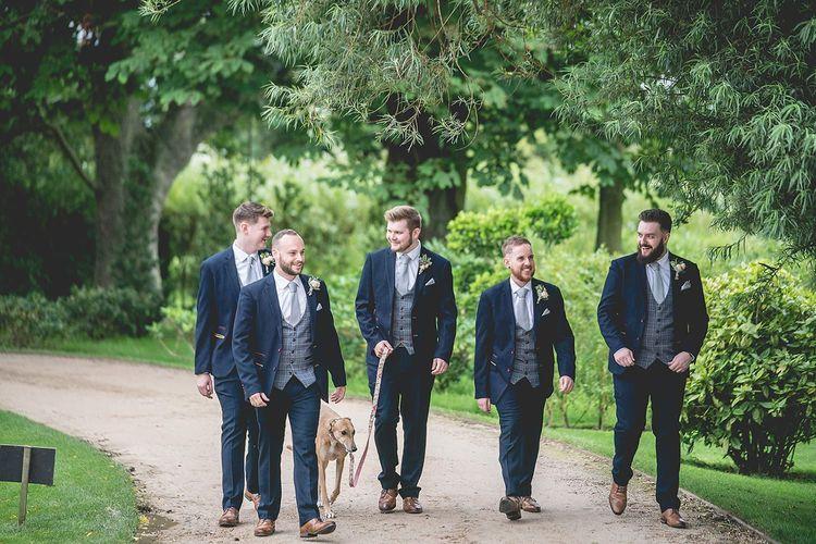 Groom and groomsmen in wedding suits at Newton Hall wedding