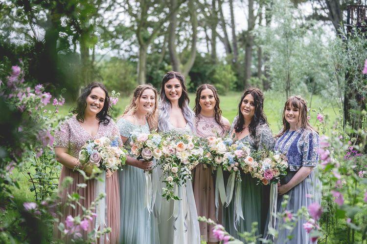 Pastel bridesmaid dresses with pale pastel bouquets