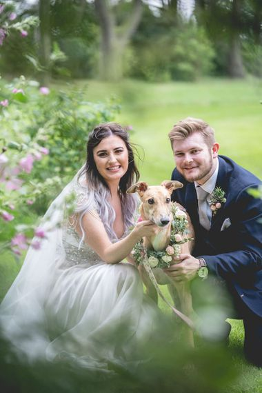 Bride and groom with their pet dog at Newton Hall