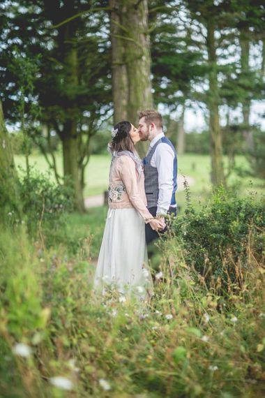 Bride in personalised wedding jacket