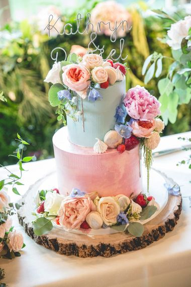 Pretty pastel wedding cake with floral decor