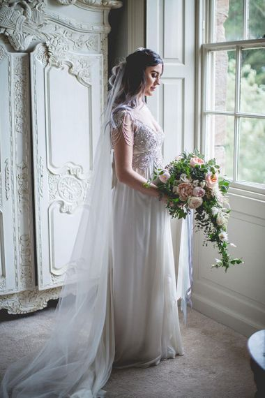 Bride with pink bouquet at Newton Hall wedding