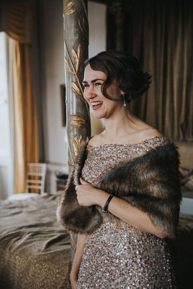 Bridesmaid In Gold Sequin Dress with Faux Fur Wrap Around