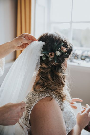 Bridal Braids With Flower Accessories and Veil