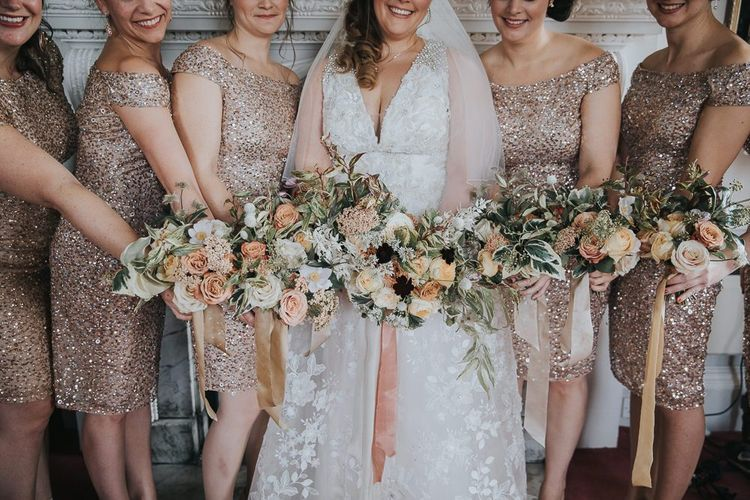 Bridal Party In Gold Bridesmaid Dresses With Bouquets