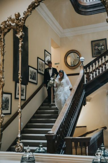 Bride Comes Down The Staircase With Father at Oxfordshire Wedding Venue